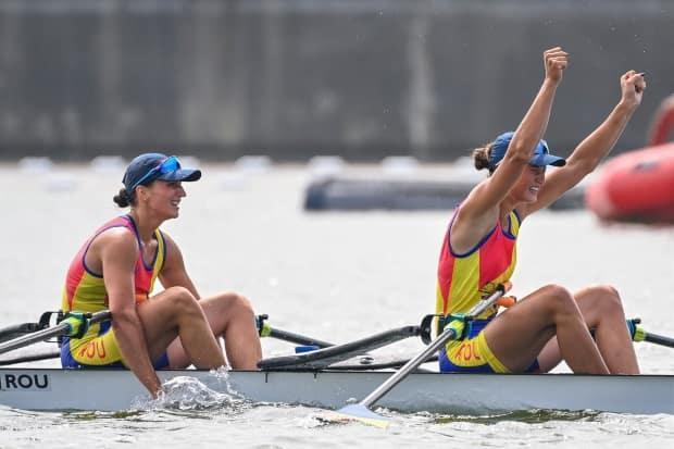 Romania's Ancuta Bodnar, left, and Simona Radis celebrate after winning gold in the women's double sculls final on Wednesday. (Charly Triballeau/AFP/Getty Images - image credit)