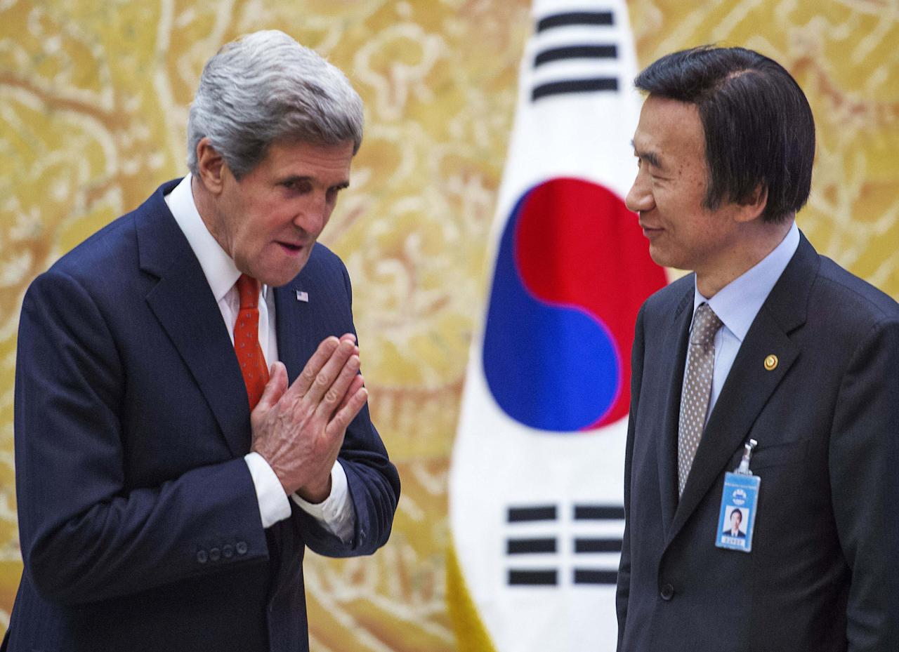 U.S. Secretary of State John Kerry, left, gestures as he meets South Korea's Foreign Minister Yun Byung-se before the arrival of South Korean's President Park Geun-hye at the presidential Blue House in Seoul, Friday, April 12, 2013. (AP Photo/Paul Richard, Pool)