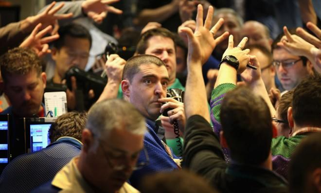 Traders signal offers in the Standard & Poor's 500 stock index options pit at the Chicago Board Options Exchange, March 20.