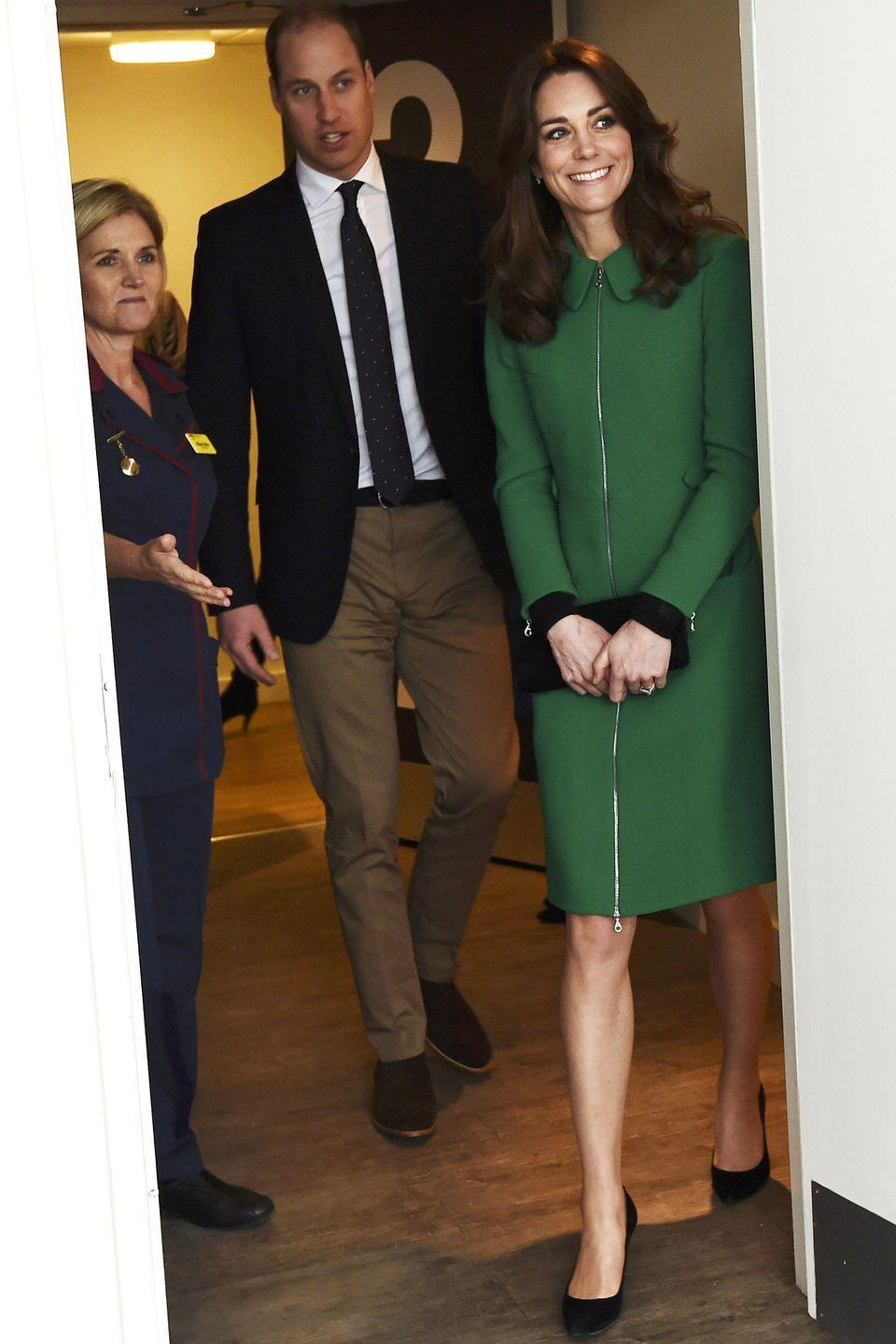 <p>Kate Middleton looked chic in a bright green coat and black pumps, while visiting St Thomas' Hospital in London to work towards preventing suicide with Prince William. </p>