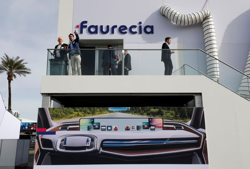 FILE PHOTO: An illustration shows a car dashboard with a giant screen on the side of the Faurecia booth during the 2019 CES in Las Vegas
