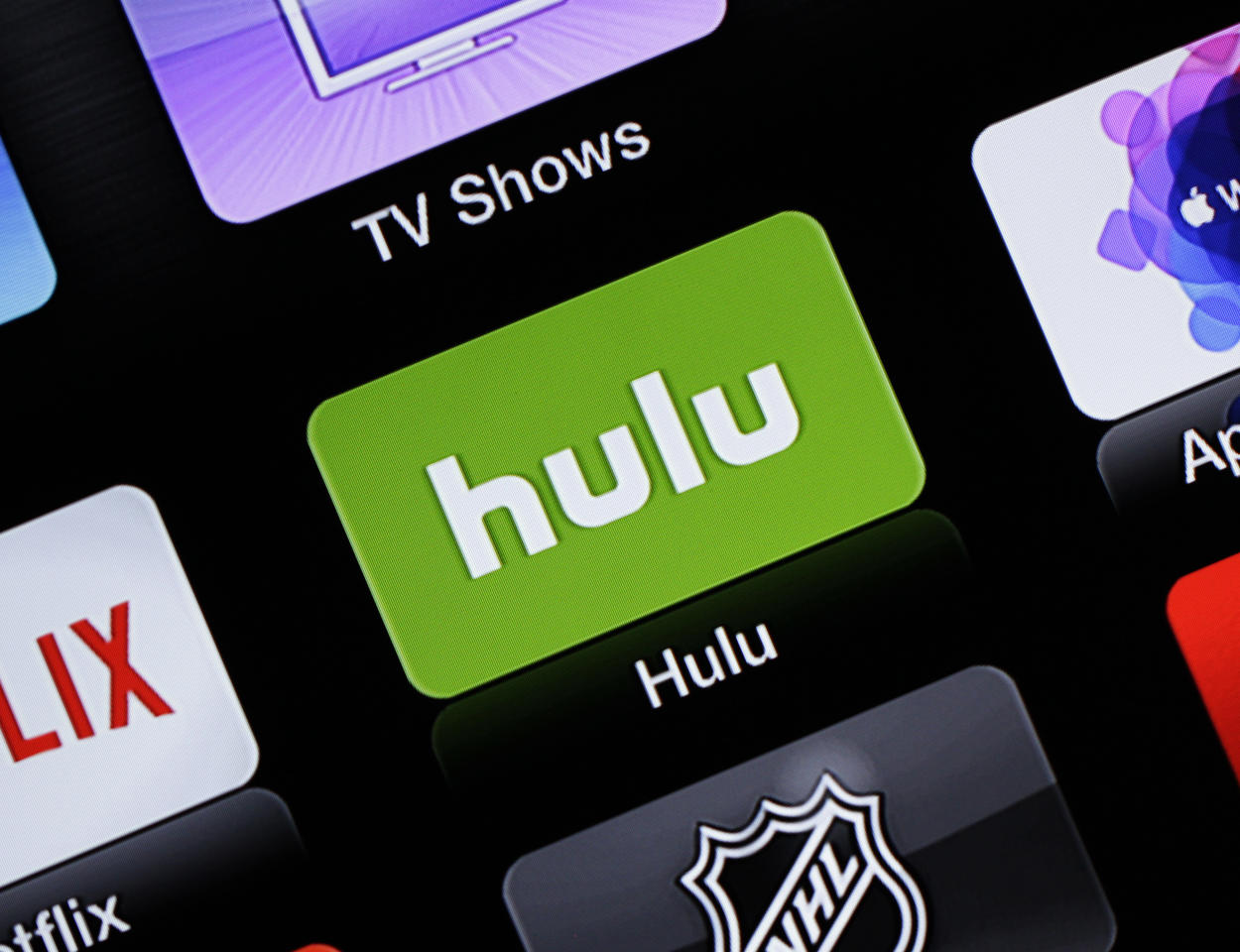 FILE - This June 24, 2015, file photo shows the Hulu Apple TV app icon. Nielsen says it will start counting how many people are watching live TV services from online streaming companies Hulu and YouTube, giving media companies and advertisers more insight on how many folks are watching network shows beyond the traditional TV screen. (AP Photo/Dan Goodman, File)