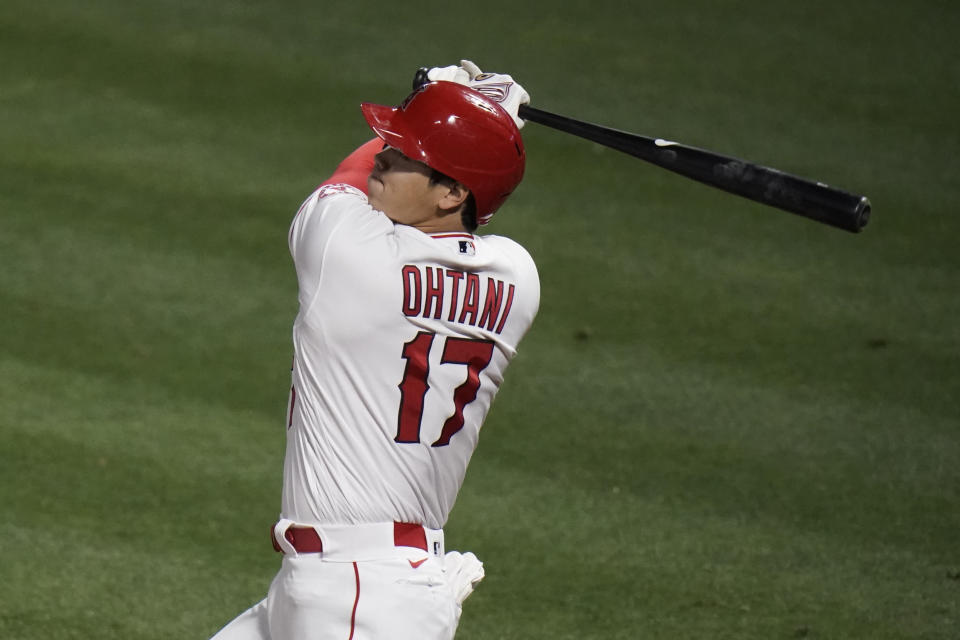Los Angeles Angels' Shohei Ohtani, of Japan, watches his double during the fifth inning of a baseball game against the Los Angeles Dodgers, Friday, May 7, 2021, in Anaheim, Calif. (AP Photo/Jae C. Hong)