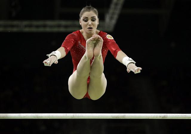 <p>Russia's Aliya Mustafina performs on the uneven bars during the artistic gymnastics women's apparatus final at the 2016 Summer Olympics in Rio de Janeiro, Brazil, Sunday, Aug. 14, 2016. (AP Photo/Dmitri Lovetsky) </p>