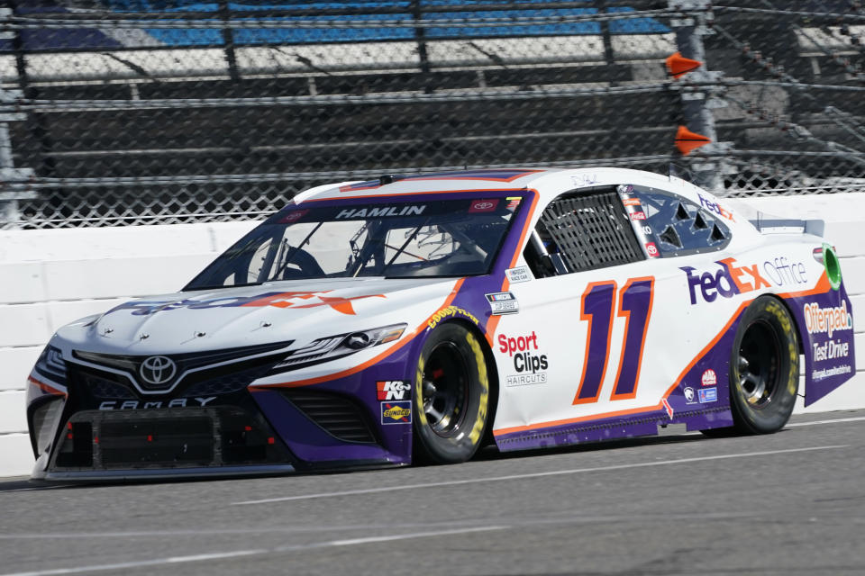 wld Denny Hamlin (11) approaches the third turn during the NASCAR Cup Series auto race at Martinsville Speedway in Martinsville, Va., Sunday, April 11, 2021. (AP Photo/Steve Helber)