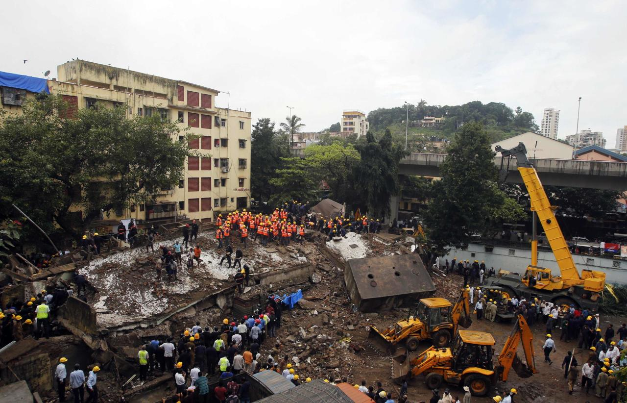 Rescue crews search for survivors at the site of a collapsed residential building in Mumbai September 27, 2013. The five-storey apartment block collapsed on Friday in the Indian financial centre of Mumbai, killing one person with dozens feared trapped in the latest accident to underscore shoddy building standards in Asia's third-largest economy. REUTERS/Danish Siddiqui (INDIA - Tags: DISASTER)