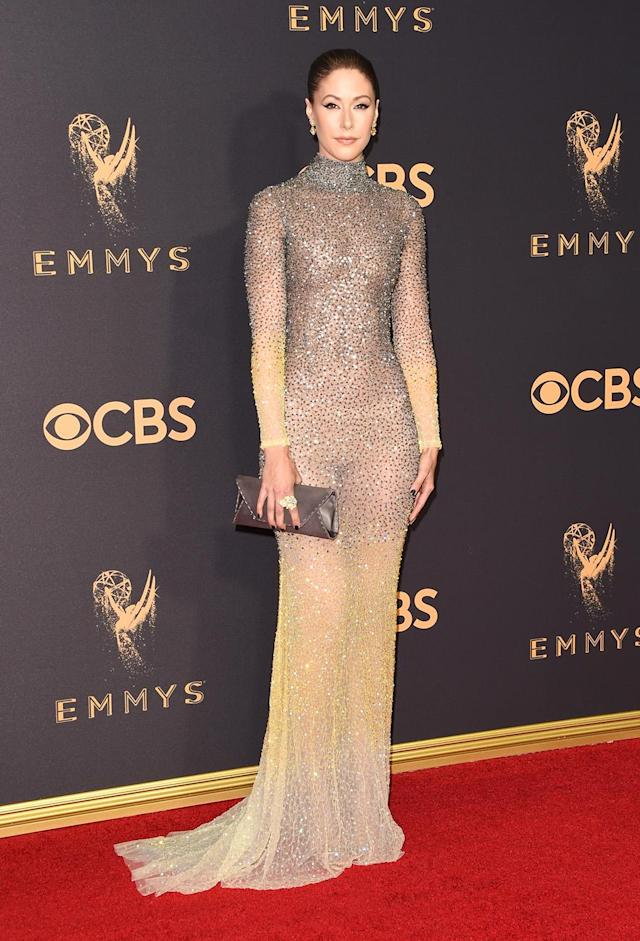 <p>The <em>Silicon Valley</em> actress looked unrecognizable in a sequin dress. While it completely covered her up — including a high neckline and long sleeves — the formfitting bodice gave off the illusion of being much more risqué than it actually is. (Photo: Getty Images) </p>