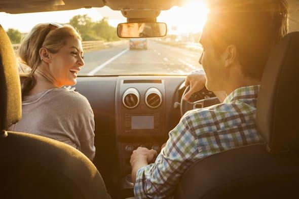 Young couple driving in car