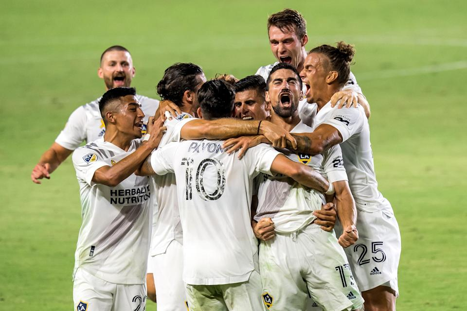 """The Los Angeles Galaxy celebrate <a class=""""link rapid-noclick-resp"""" href=""""/soccer/players/379151/"""" data-ylk=""""slk:Sebastian Lletget"""">Sebastian Lletget</a>'s first goal on Sunday in a 3-0 win over LAFC. (Photo by Shaun Clark/Getty Images)"""