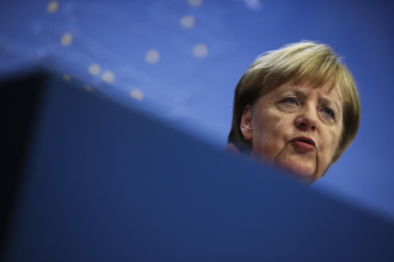 German Chancellor Angela Merkel speaks during a media conference during an EU summit in Brussels, Friday, Dec. 13, 2019. European Union leaders gathered for their year-end summit and discussed climate change funding, the departure of the UK from the bloc and their next 7-year budget. (AP Photo/Francisco Seco)