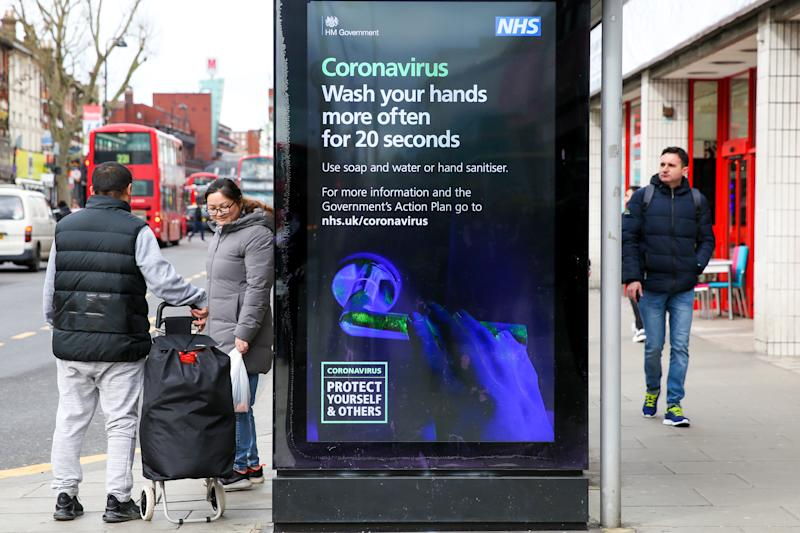 People walk past a Coronavirus public information campaign poster in London, which focuses on hand washing. Five coronavirus victims have died and 319 cases have tested positive for the virus. (Photo by Dinendra Haria / SOPA Images/Sipa USA)