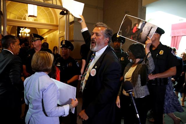 <p>Rep. Juan Vargas, D-Calif., and other Democratic members of Congress protest family separations at the U.S.-Mexico border as President Trump departs after addressing a closed House Republican Conference meeting on Capitol Hill in Washington, D.C., June 19, 2018. (Photo: Joshua Roberts/Reuters) </p>
