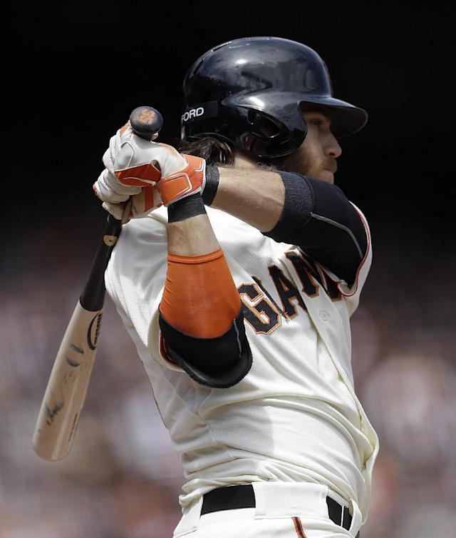 San Francisco Giants' Brandon Crawford swings for an RBI double off Cleveland Indians' Danny Salazar in the fourth inning of a baseball game, Sunday, April 27, 2014, in San Francisco. (AP Photo/Ben Margot)