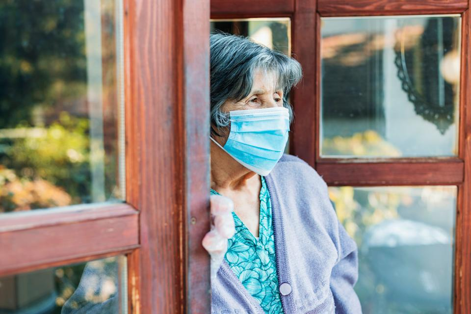 Senior woman with facial mask,Covid 19. (Photo: Sladic via Getty Images)