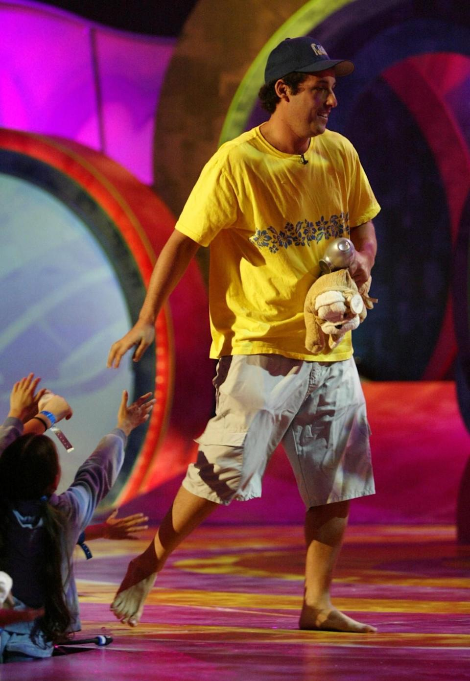 <p>Sandler accepted his Kids' Choice Award sans shoes. (Photo: Frank Micelotta/Getty Images)</p>