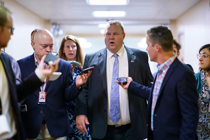 Sen. Jon Tester, D-Mont., a negotiator in the infrastructure talks, arrives for votes at the Capitol in Washington, Tuesday, July 13, 2021. Yesterday, Sen. Bernie Sanders, I-Vt., chair of the Senate Budget Committee, met at the White House with President Joe Biden to address roadblocks on on an infrastructure agreement. (AP Photo/J. Scott Applewhite) ORG XMIT: DCSA103