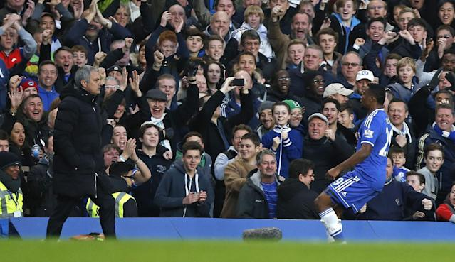 Chelsea's Samuel Eto'o, right, runs toward his manager Jose Mourinho after scoring the opening goal against Manchester United during their English Premier League soccer match at Stamford Bridge, London, Sunday, Jan. 19, 2014. (AP Photo/Sang Tan)
