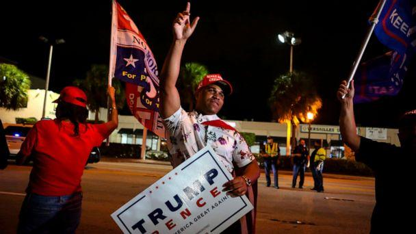 PHOTO: Supporters of President Donald Trump rally in front of Cuban restaurant Versailles in Miami, early Nov. 4, 2020. (Eva Marie Uzcategui/AFP via Getty Images)