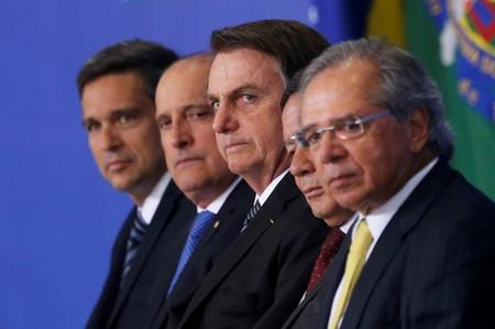 FILE PHOTO: Brazil's Central Bank President Roberto Campos Neto, Chief of Staff Minister Onyx Lorenzoni, Brazil's President Jair Bolsonaro, Brazil«s  Vice President Hamilton Mourao and Brazil's Economy Minister Paulo Guedes attend a ceremony at the Planal