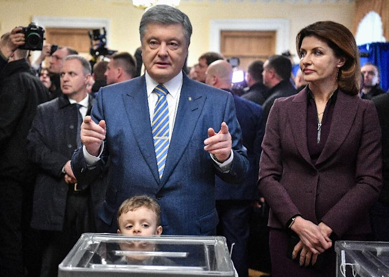 "Poroshenko has called his rival a ""clown"" and a ""puppet"" of oligarch Igor Kolomoysky (AFP Photo/Sergei SUPINSKY)"