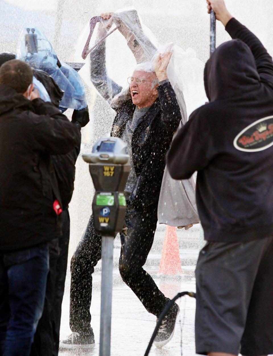 <p>Larry David gets soaked in the rain while filming <em>Curb Your Enthusiasm</em> for its upcoming season on Wednesday in L.A.</p>