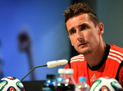 Miroslav Klose answers questions during a press conference on Thursday. (AFP)