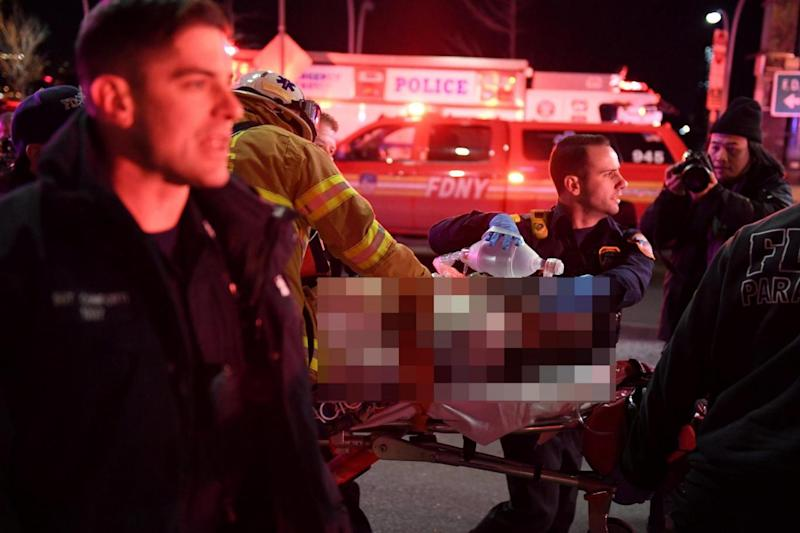 New York: Paramedics and members of the NYFD perform CPR on a victim of the crash (REUTERS)