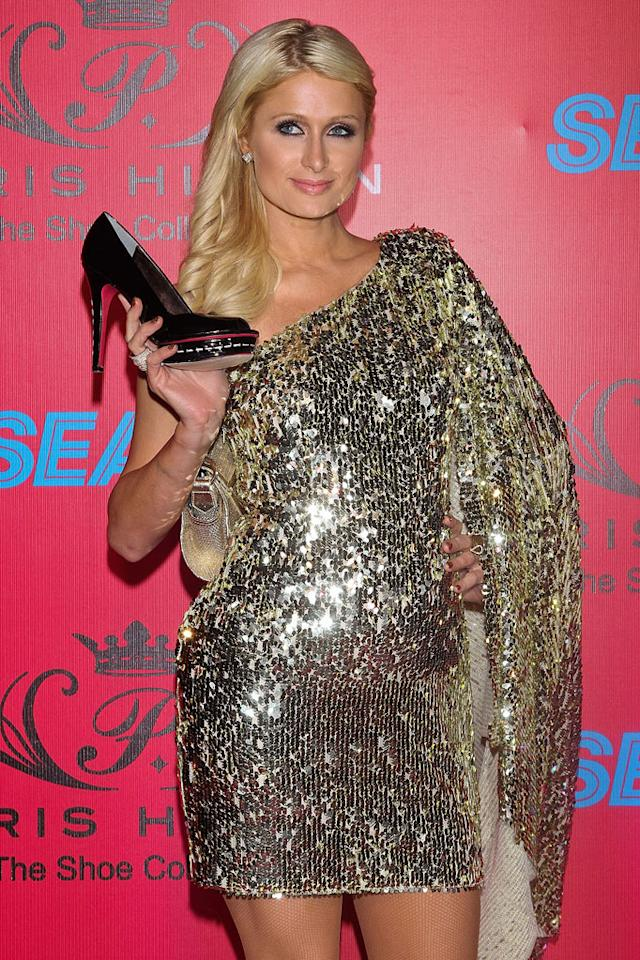 """Paris Hilton looks to be """"in the family way,"""" announces <i>In Touch</i>. The reality star had """"mouths gaping,"""" says the mag, with her """"blossoming belly"""" at a recent event to launch her shoe line. According to the magazine, Hilton, who recently went ring shopping with boyfriend Cy Waits, is definitely """"looking considerably fuller around the mid-section."""" For how far along Hilton is, and when to expect a formal announcement, check out what her rep reveals to <a href=""""http://www.gossipcop.com/paris-hilton-baby-bump-pregnant/"""" target=""""new"""">Gossip Cop</a>. Victor Chavez/WireImage - March 29, 2011"""
