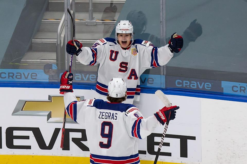 EDMONTON, AB - JANUARY 05: Trevor Zegras #9 and Alex Turcotte #15 of the United States celebrate a goal against Canada during the 2021 IIHF World Junior Championship gold medal game at Rogers Place on January 5, 2021 in Edmonton, Canada. (Photo by Codie McLachlan/Getty Images)