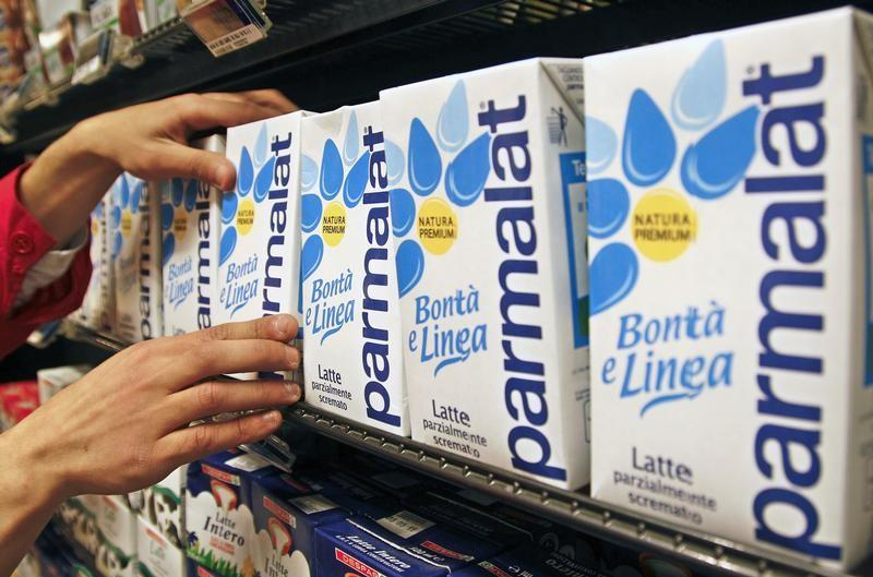 A worker checks cartons of milk in a supermarket in Rome