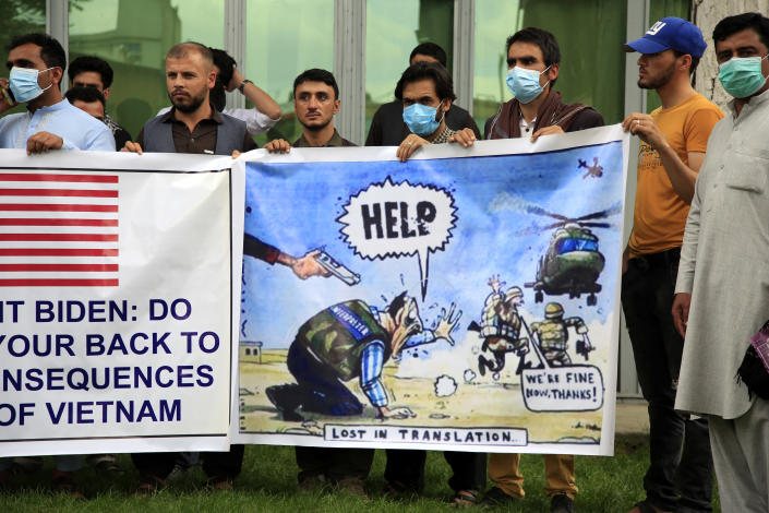 In this Friday, April 30, 2021, photo former Afghan interpreters hold banners during a protest against the U.S. government and NATO in Kabul, Afghanistan. (AP Photo/Mariam Zuhaib)