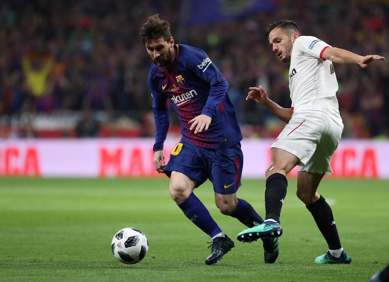 Soccer Football - Spanish King's Cup Final - FC Barcelona v Sevilla - Wanda Metropolitano, Madrid, Spain - April 21, 2018   Barcelona's Lionel Messi in action with Sevilla's Pablo Sarabia   REUTERS/Susana Vera