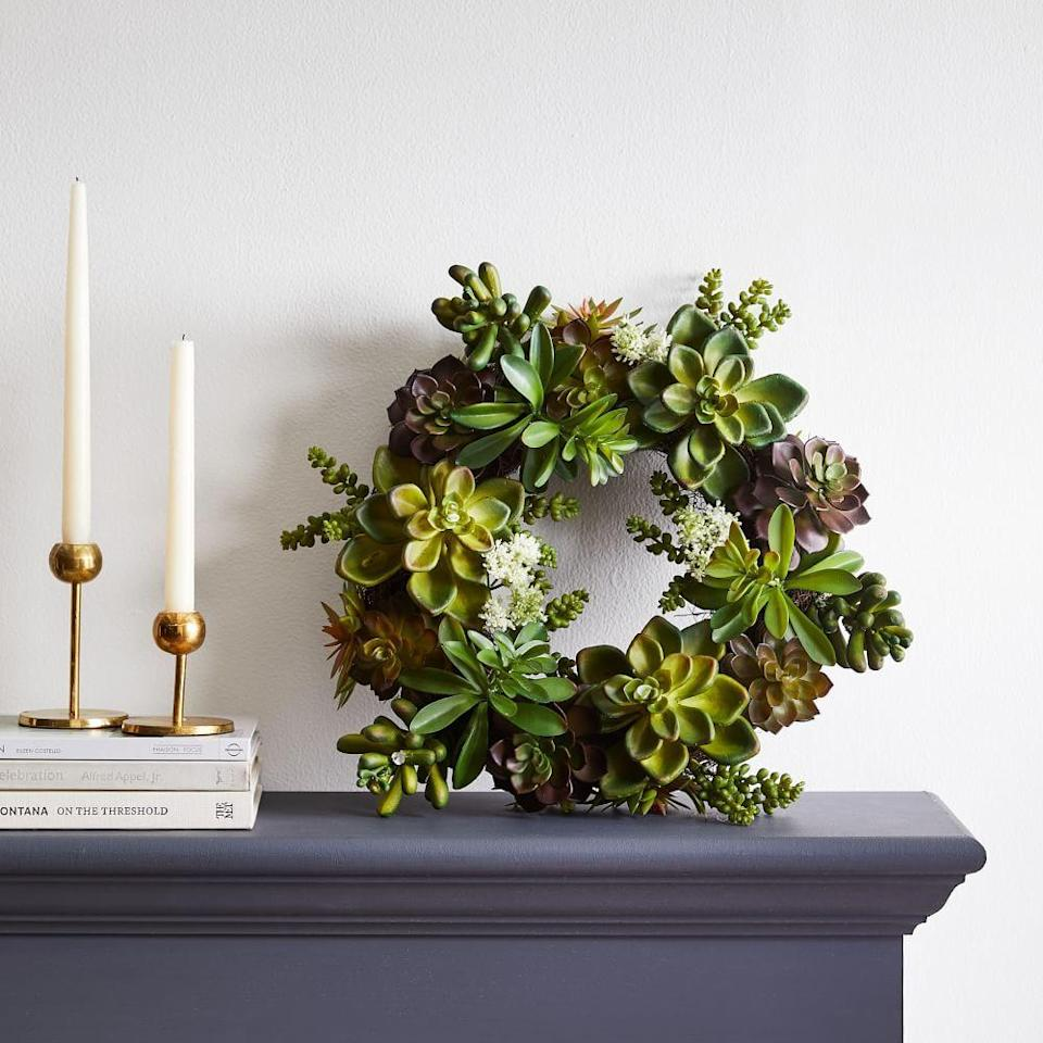 """<p><strong>West Elm</strong></p><p>westelm.com</p><p><strong>$103.00</strong></p><p><a href=""""https://go.redirectingat.com?id=74968X1596630&url=https%3A%2F%2Fwww.westelm.com%2Fproducts%2Ffaux-succulent-wreath-d11037&sref=https%3A%2F%2Fwww.housebeautiful.com%2Fhome-remodeling%2Fdiy-projects%2Fg2586%2Ffall-wreaths%2F"""" rel=""""nofollow noopener"""" target=""""_blank"""" data-ylk=""""slk:BUY NOW"""" class=""""link rapid-noclick-resp"""">BUY NOW</a></p><p>If you live in the desert or somewhere relatively warm even during the fall months, reflect the climate with a succulent wreath. </p>"""
