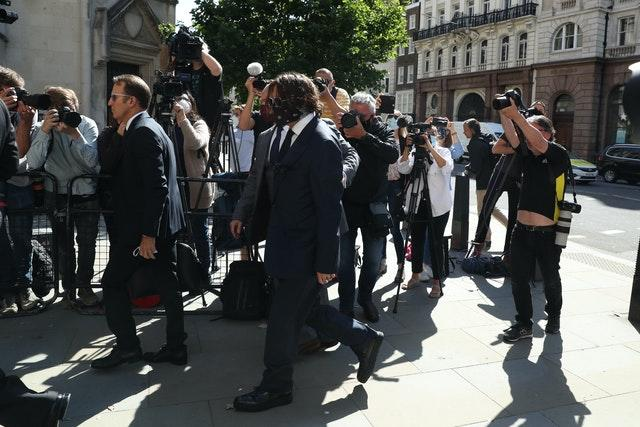 Actor Johnny Depp, centre, arriving at the High Court in London for a hearing in his libel case against the publishers of The Sun and its executive editor Dan Wootton
