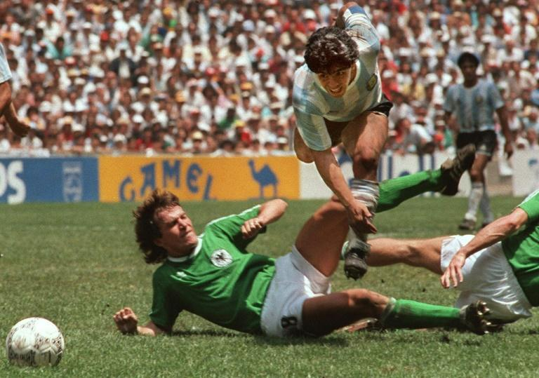 Diego Maradona evades a tackle from Lothar Matthaus in the 1986 World Cup final which saw Argentina beat West Germany 3-2