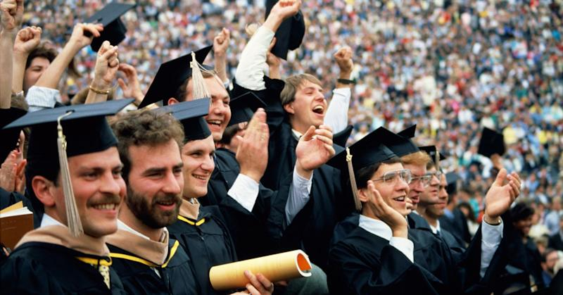 College students graduating.