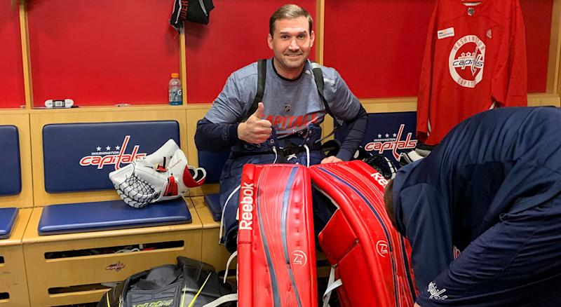 Ryan Zimmerman traded in his first base mitt for a goalie glove on Wednesday. (@Capitals/Twitter)