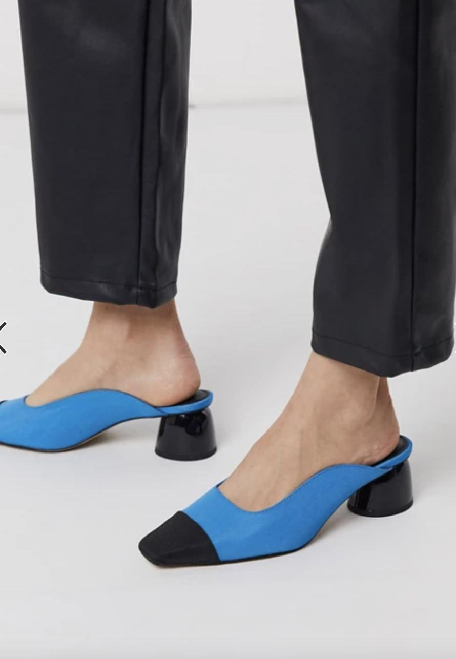 <p>Get read for spring with these adorable <span>ASOS Slaide Block Heeled Mules </span> ($29, originally $48).</p>