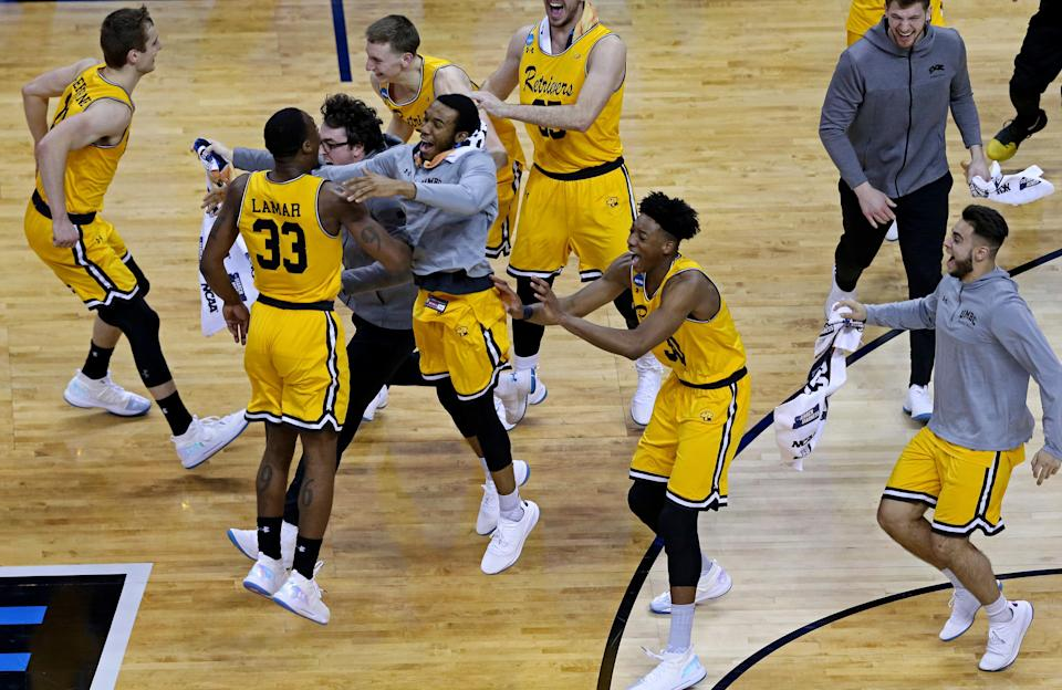<p>UMBC Retrievers celebrates beating Virginia Cavaliers in the first round of the 2018 NCAA Tournament at Spectrum Center. Mandatory Credit: Peter Casey-USA TODAY Sports </p>