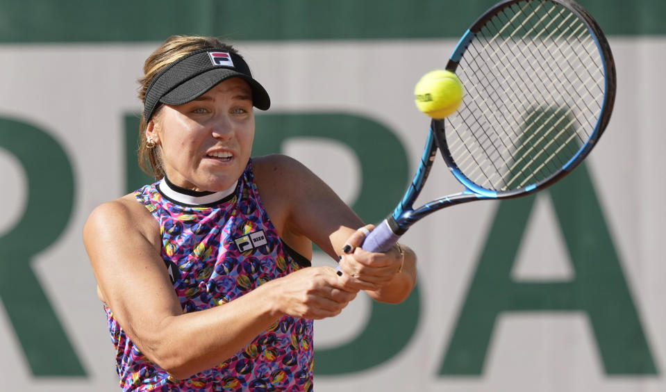 United States's Sofia Kenin plays a return to Ukraine's Elina Ostapenko during their first round match on day two of the French Open tennis tournament at Roland Garros in Paris, France, Monday, May 31, 2021. (AP Photo/Michel Euler)