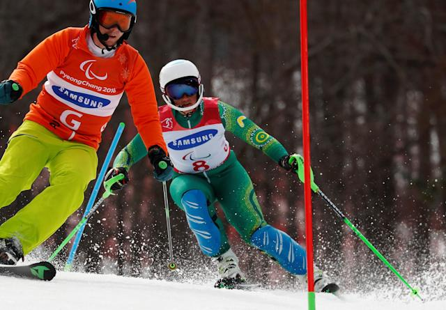 Alpine Skiing - Pyeongchang 2018 Winter Paralympics - Women's Slalom - Visually Impaired - Run 2 - Jeongseon Alpine Centre - Jeongseon, South Korea - March 18, 2018 - Melissa Perrine of Australia and her guide. REUTERS/Paul Hanna