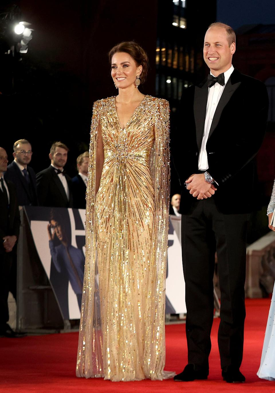 <p>The Duchess of Cambridge wore a gold sequined cape dress from Jenny Packham. </p>