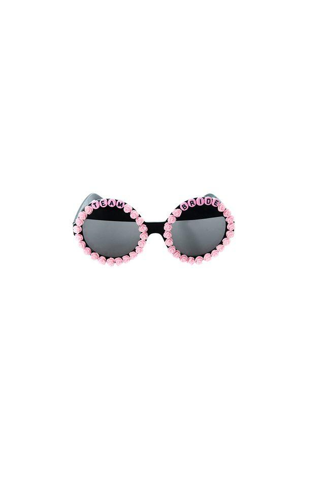 """<p>The chance of losing a pair of prized (and costly) sunnies is pretty big in a city like Vegas, so embrace the kitschy nature of a bachelorette party and go with a fun pair of wedding-themed shades.</p><p><em></em><em>Team Bride Rounds, $55</em></p><a class=""""body-btn-link"""" href=""""https://www.radandrefined.com/rad-bride/fz22p5btfa83fz37l9xsbxkl9ezoks"""" target=""""_blank"""">SHOP</a>"""