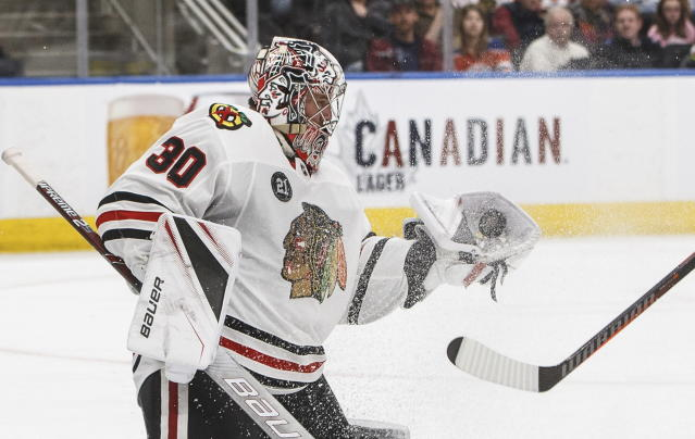 Chicago Blackhawks goalie Cam Ward makes a save against the Edmonton Oilers during the second period of an NHL hockey game Tuesday, Feb. 5, 2019, in Edmonton, Alberta. (Jason Franson/The Canadian Press via AP)