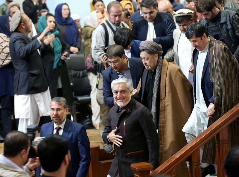 Afghanistan's presidential candidate Abdullah Abdullah arrives to attend a gathering with his supporters in Kabul