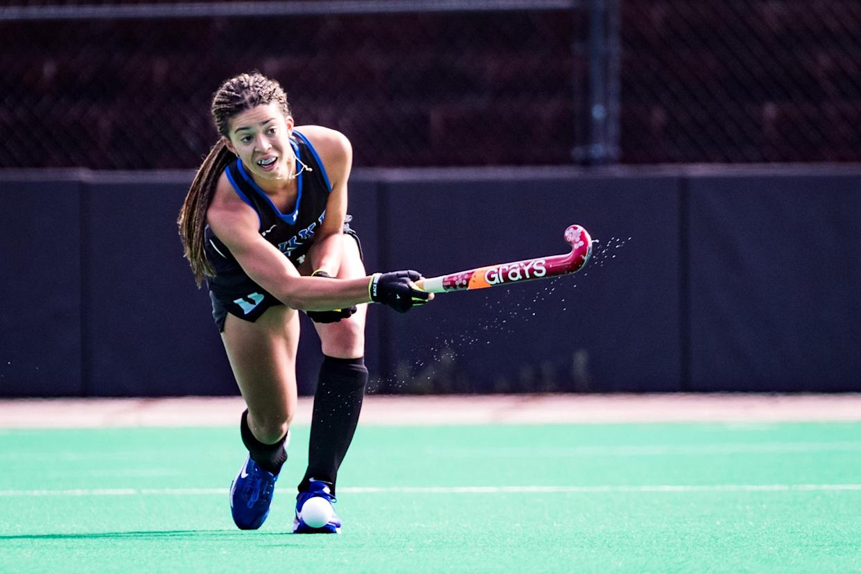 Darcy Bourne hits the ball playing for Duke University