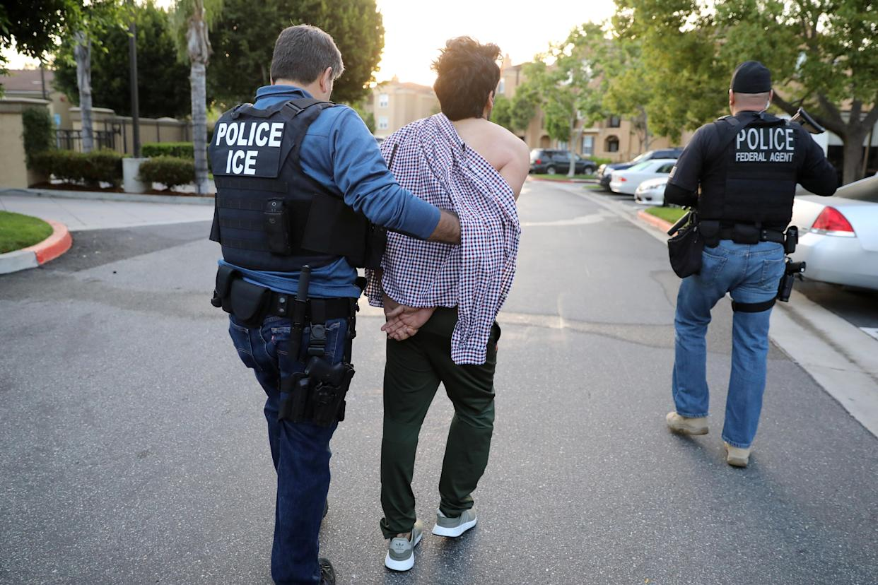 U.S. Immigration and Customs Enforcement (ICE) Assistant Field Office Director Jorge Field, 53, left, arrests an Iranian immigrant in San Clemente, Calif., in May 2017. (Photo: Lucy Nicholson/Reuters)
