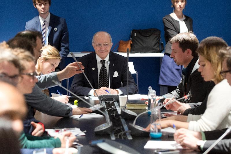 French Foreign Affairs minister Laurent Fabius (C) meets NGO members as part of the COP 21 UN conference on climate change in Le Bourget near Paris on December 8, 2015 (AFP Photo/Alain Jocard)