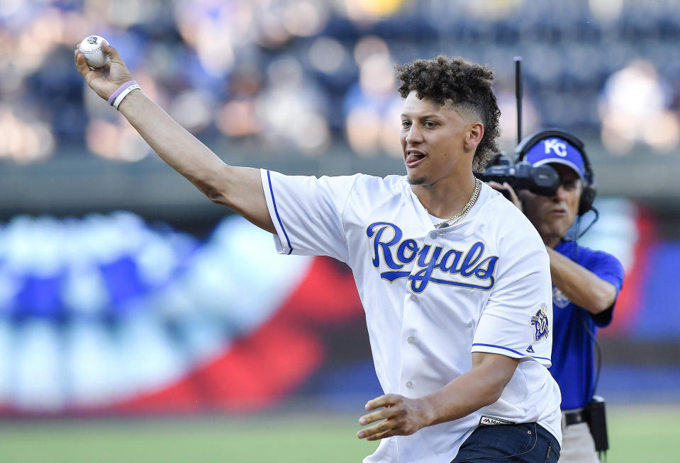 Patrick Mahomes shows off his arm throwing out the first pitch before a Royals game in 2018. Mahomes, the son of former Major League Baseball player Patrick Mahomes Sr., played baseball in high school. (John Sleezer/Kansas City Star/Tribune News Service via Getty Images)