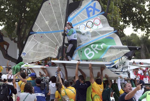 2016 Rio Olympics - Sailing - Final - Women's Skiff - 49er FX - Medal Race - Marina de Gloria - Rio de Janeiro, Brazil - 18/08/2016. Martine Grael (BRA) of Brazil celebrates winning gold medal. REUTERS/Benoit Tessier FOR EDITORIAL USE ONLY. NOT FOR SALE FOR MARKETING OR ADVERTISING CAMPAIGNS.